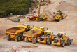 Large lorry trucks and tractors in a quarry
