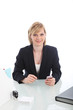 Young business executive sitting at her desk