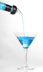 Tasty blue cocktail isolated on white
