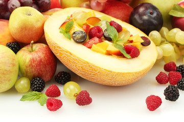 fresh fruits salad in melon, fruits and berries, isolated