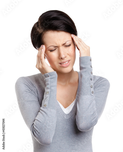 Girl has a headache, isolated on white