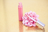 pink lipgloss with flower petals