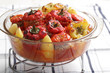 Stuffed tomatoes and peppers in the glass casserole