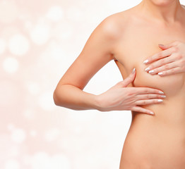 woman controls her breast for cancer, self test