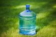 water bottle on green grass background