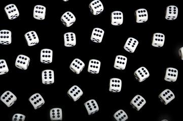 Gambling background - white dice on black background