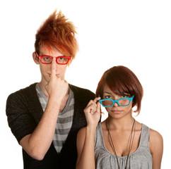 Eccentric Couple Adjusting Glasses