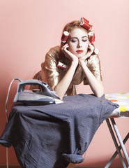 Housewife with iron and curler