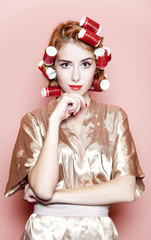 Redhead girl with curlers