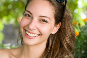 Happy young brunette woman with amazing smile.