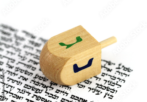 Jewish Hanukkah Dreidel on Top of Shema Yisrael  Text in Hebrew.