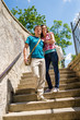 Young happy couple walking down stairs smiling