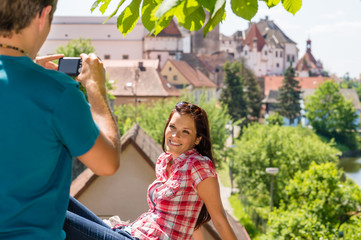 Young woman being photographed in romantic city