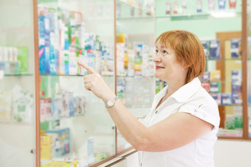 woman chooses drugs at pharmacy