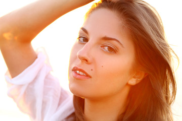 Portrait of beautiful woman in sunset light