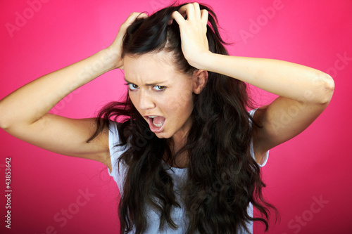 very angry frustrated young woman