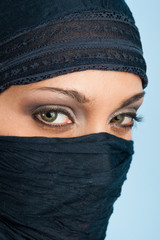 Portrait of veiled woman, focus on eyes.