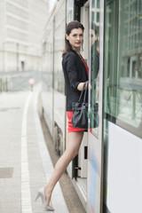 Woman boarding a tram