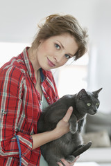 Woman holding a grey cat