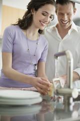Woman washing utensils in the kitchen