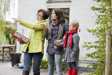 Real estate agent showing woman a house