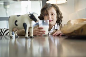 Portrait of a boy drinking a glass of milk