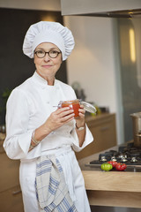 Woman holding a jar of tomato sauce