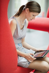 Businesswoman using digital tablet in an office