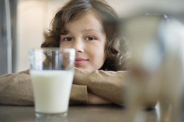 Portrait of a boy with a glass of milk