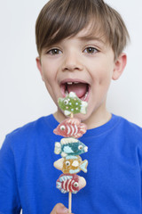 Boy eating candies