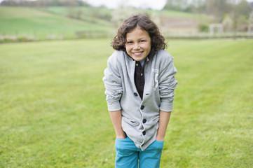 Portrait of a boy smiling in a field