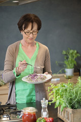 Woman tasting food