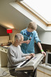 Man playing an electric piano with his son at home