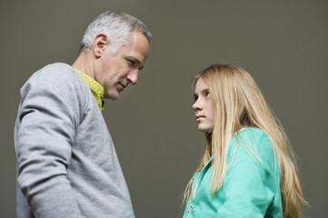 Man and daughter frowning to each other