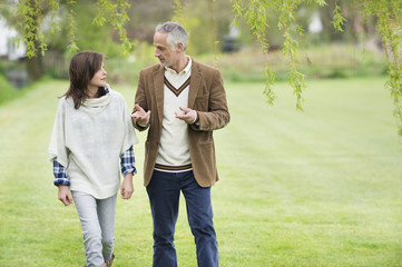 Man discussing with his daughter during walk in a park