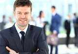 Successful businessman at the office leading a