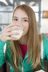 Portrait of a girl drinking milk