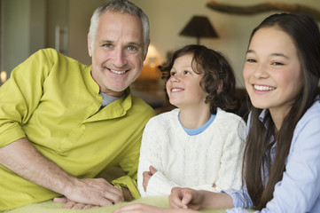 Portrait of a man with his children smiling