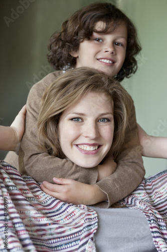 Portrait of a woman smiling with his son