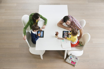 High angle view of couple teaching their children