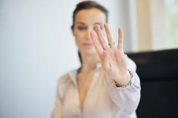 Businesswoman showing her wedding ring