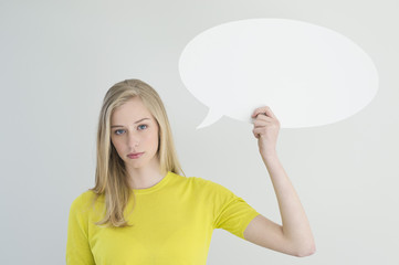Serious woman holding a speech bubble