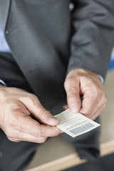 Close-up of a businessman holding a business card