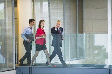 Business executives walking in an office corridor