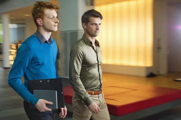 Businessmen walking in an office corridor