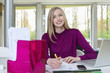 Happy businesswoman working in home office