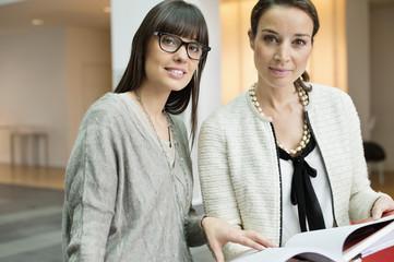 Portrait of two businesswomen working in an office