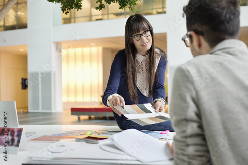 Fashion designers discussing in an office