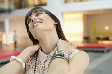 Close-up of a businesswoman suffering from neckache