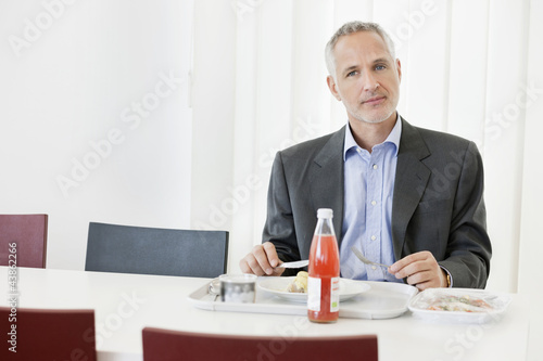 Businessman having lunch in the office